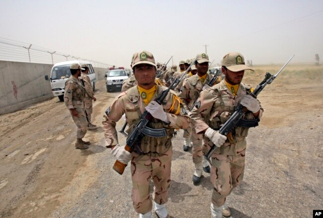 FILE - A group of Iranian border guards march at the eastern border of Iran shared with Pakistan, July 19, 2011.
