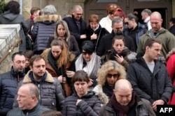 Mourners leave the service of remembrance at the Saint Etienne Church in Trebes in southwest France, March 25, 2018, two days after Radouane Lakdim carried out an attack in which four people were killed.
