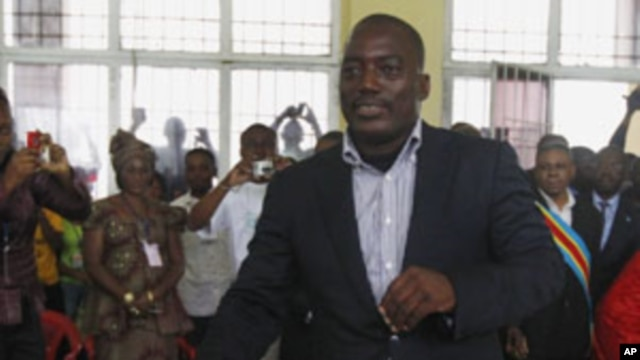 Congolese president Joseph Kabila casts his ballot in the country's presidential election at a polling station in Kinshasa, Democratic Republic of Congo, Monday Nov. 28, 2011