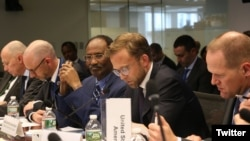 Somali Finance Minister Abdirahman Duale Beileh (center) is seen flanked by participants of International Monetary Fund (IMF) and World Bank meetings last week in Washington. (Twitter - @DrBeileh)