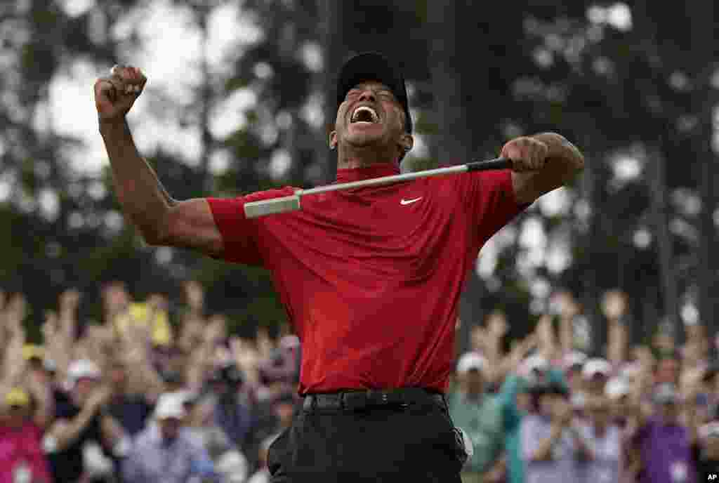Tiger Woods reacts as he wins the Masters golf tournament, April 14, 2019, in Augusta, Georgia, USA.