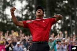 Tiger Woods reacts as he wins the Masters golf tournament, April 14, 2019, in Augusta, Georgia.