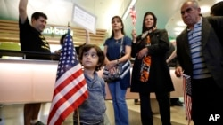 In this photo from Jan. 29, 2017, Shayan Ara, 3, holds an American flag at a protest against President Donald Trump's executive order banning travel from seven Muslim-majority countries at Los Angeles International Airport in California.