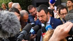 FILE - Italy's Interior Minister Matteo Salvini speaks to the media after a meeting in Innsbruck, Austria, July 11, 2018.