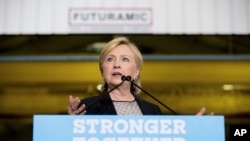 Democratic presidential candidate Hillary Clinton gives a speech on the economy after touring Futuramic Tool & Engineering, in Warren, Mich., Aug. 11, 2016.