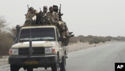Chadian troops ride toward lake Chad near Bashoum, Chad, as large contingents of Chadian troops were seen heading the the region bordering Nigeria, March 6, 2015.