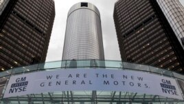 A banner hangs at the front of the General Motors Co world headquarters announcing GM's return to the New York Stock Exchange (NYSE) in Detroit, Michigan, Nov. 18, 2010.