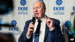 FILE - Chairman of the Estonian Conservative People's Party (EKRE) Mart Helme speaks at the headquarters after parliamentary elections in Tallinn, Estonia, March 4, 2019.