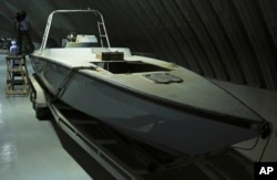 """FILE - A craft described as a """"drone boat,"""" once loaded with explosives by Shiite rebels in Yemen, is displayed at a military installation in the United Arab Emirates, June 19, 2018. Officials involved in the Saudi-led campaign against Shiite rebels in Yemen, known as Houthis, showed journalists materiel captured on the battlefield that they alleged show Iran's hand in arming the rebels."""