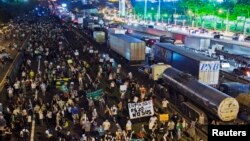 Demonstrators take over part of one of the country's main highways, during a protest in Sao Jose dos Campos.