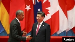 U.S. President Barack Obama and Chinese President Xi Jinping speak during the G20 Summit in Hangzhou, September 4, 2016.