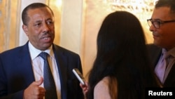 FILE - Libya's Prime Minister Abdullah al-Thinni speaks to reporters in Abu Dhabi.