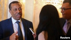 Libya's Prime Minister Abdullah al-Thinni speaks to reporters in Abu Dhabi, Sept. 10, 2014.