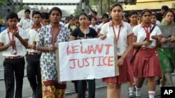 Students of the Convent of Jesus and Mary School protest the gang rape of a nun in her 70s by a group of bandits, which occurred in Ranaghat, northeast of Kolkata in India's West Bengal state, March 14, 2015.