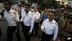 India's national carrier Air India pilots, who are on strike for the ninth consecutive day, join a rally against corruption in Kolkata, May 5, 2011