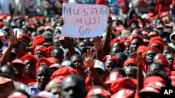 A poster showing opposition to Zimbabwe's President Robert Mugabe is seen at a final Movement For Democratic Change (MDC) campaign rally in Harare, July, 29, 2013. (File Photo)