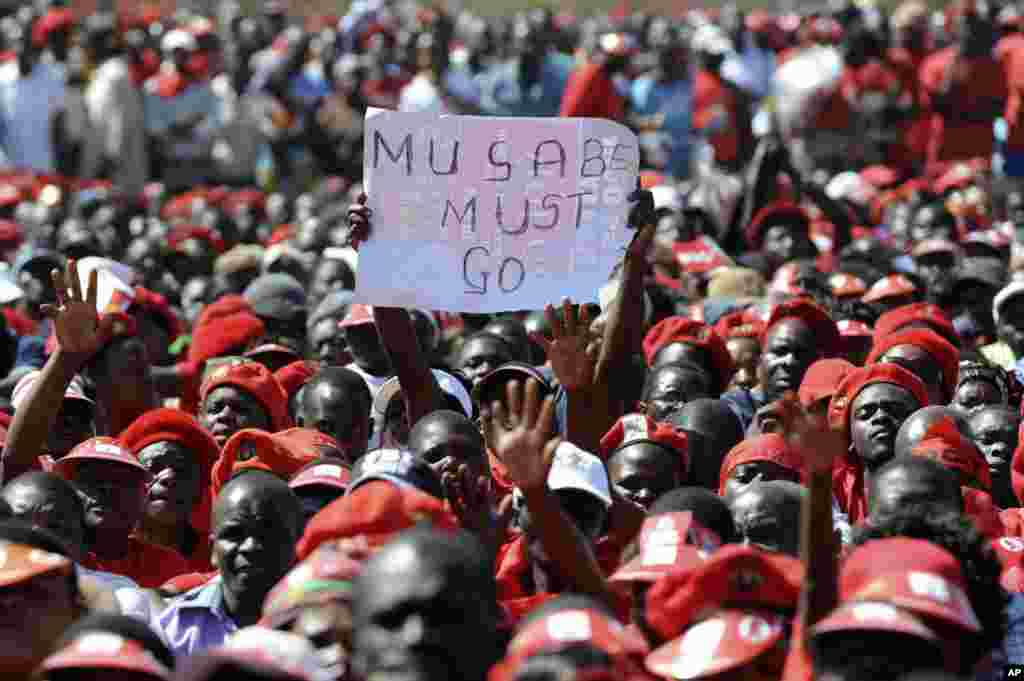 A poster showing opposition to Zimbabwe's President Robert Mugabe is seen at a final Movement For Democratic Change (MDC) campaign rally in Harare, July 29, 2013.
