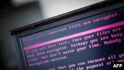 Sebuah laptop menampilkan pesan setelah terinfeksi ransomware sebagai bagian dari serangan global dunia maya, 27 Juni 2017 di Geldrop, Belanda.
