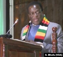 Zimbabwe's President Emmerson Mnangagwa addressing his first campaign rally in Harare on July 5, 2018 after surviving an explosion at a rally he was addressing late last month.