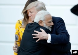 FILE - Indian Prime Minister Narendra Modi hugs President Donald Trump as Modi departs the White House, June 26, 2017.