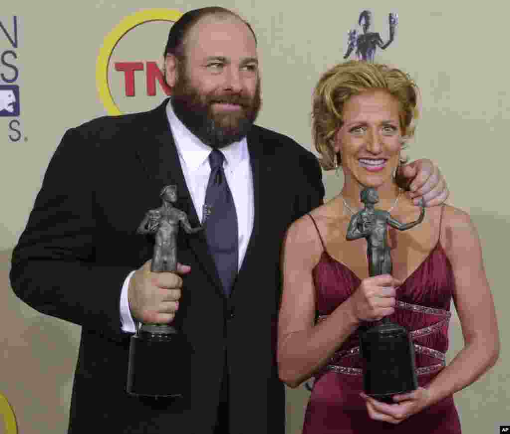 "James Gandolfini and Edie Falco display awards they received for their respective outstanding performances by lead actors in the drama series ""The Sopranos"" at the 9th annual Screen Actors Guild awards in Los Angeles, California, March 9, 2003."