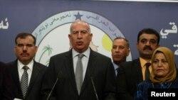 오사마 알-누자이피 이라크 국회의장이 13일, 바그다드에서 열린 기자회견에서 연설하고 있다.