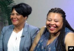 FILE -- Alice Marie Johnson, left, and her daughter Katina Marie Scales wait to start a TV interview, June 7, 2018, in Memphis, Tennessee. Johnson, convicted in 1996 on eight criminal counts, was pardoned earlier this year by Trump, who had met with Kardashian West about her case.