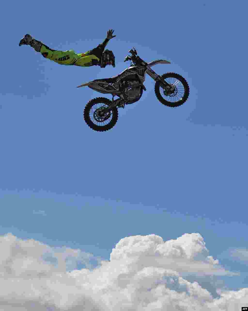 A Nitro Circus member performs above the crowd ahead of the third practice session of the Formula One Australian Grand Prix in Melbourne.