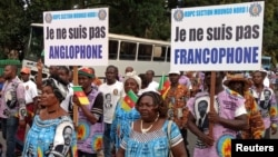 FILE - Demonstrators carry banners as they take part in a march voicing their opposition to independence or more autonomy for the Anglophone regions, in Douala, Cameroon Oct. 1, 2017.