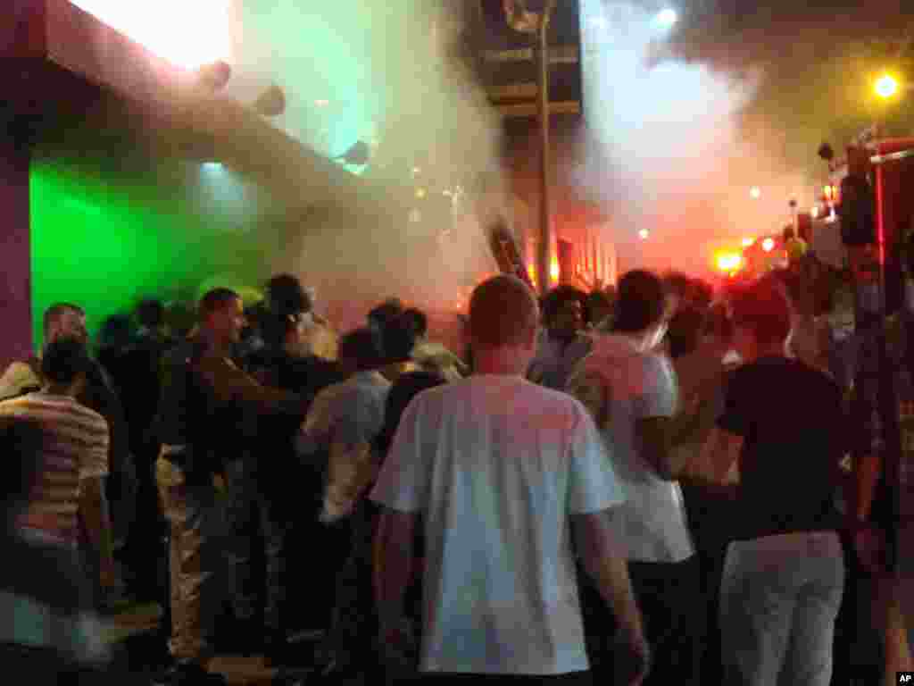 A crowd stands outside the Kiss nightclub during a fire inside the club in Santa Maria city, Rio Grande do Sul state, Brazil, January 27, 2013.
