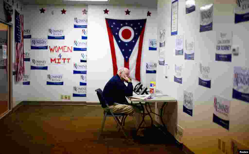 A volunteer speaks on the phone at Ohio's campaign headquarters for Mitt Romney, October 30, 2012.