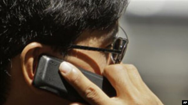 WHO Panel Cites 'Possible' Brain Cancer Risk from Cell Phone Use