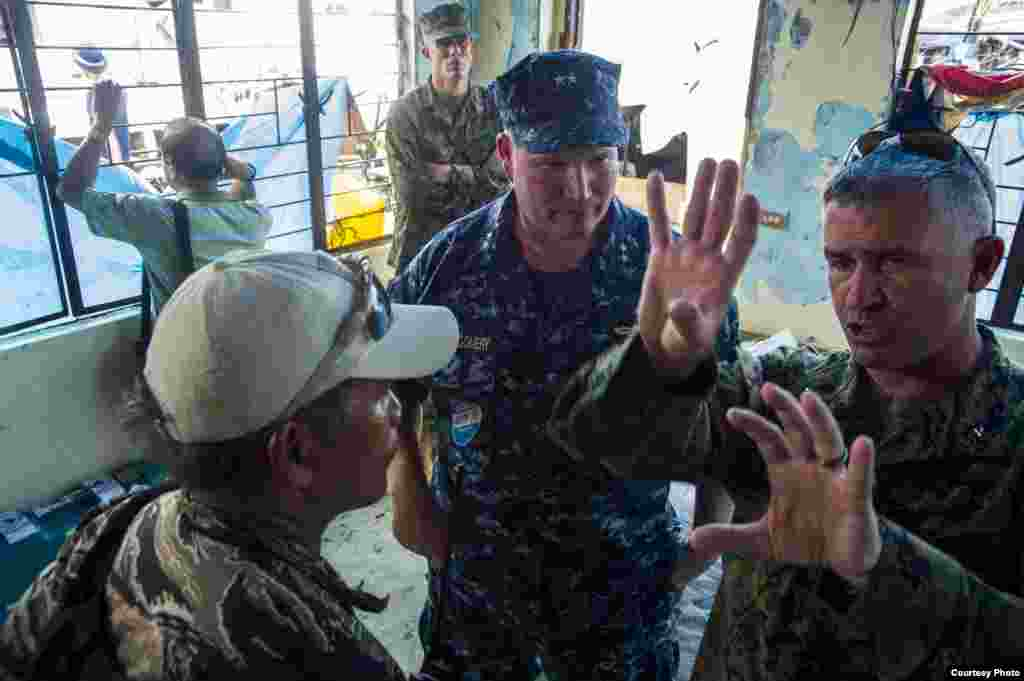 From right to left: U.S. Marine Corps Brig. Gen. Paul Kennedy, commanding general, 3d Marine Expeditionary Brigade; U.S. Navy Rear Adm. Mark Montgomery, commander, Battle Force 7th Fleet; and Philippine navy Capt. Roy Vincent Trinidad, officer in charge,