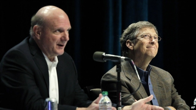 FILE - Then-Microsoft Corp. CEO Steve Ballmer (L) answers a question from a shareholder with Microsoft founder and chairman Bill Gates (R) during Microsoft's annual meeting of shareholders, on Nov. 28, 2012, in Bellevue, Washington.