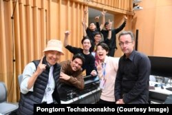 Pongtorn Techaboonakho posed with friends at Princess Galyani Vadhana Institute of Music in Bangkok.