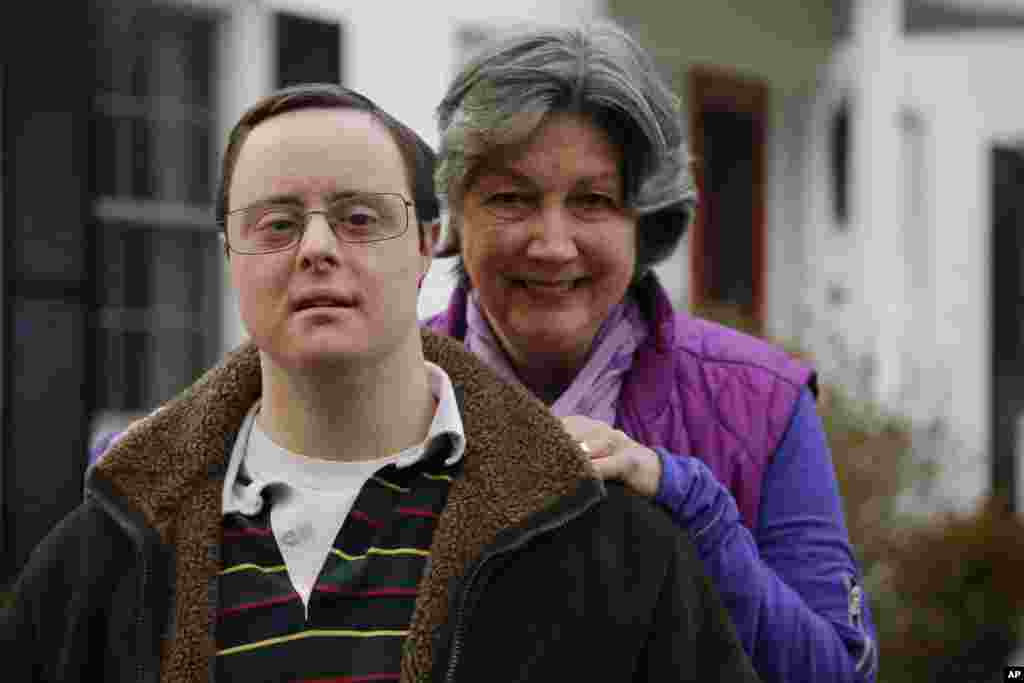 Matthew McMeekin poses with his mother, Bebe McMeekin at their home in Bethesda, Md. in this Feb. 10, 2014 file photo. Most Americans with intellectual or developmental disabilities remain shut out of the workforce, despite the ADA.