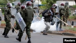 Kenyan police are seen dispersing a rally by university students in Kenya's capital Nairobi, May 20, 2014.