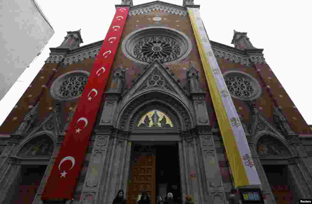 The St. Antuan Catholic church is decorated with Turkish and Vatican flags before the visit of Pope Francis in central Istanbul, Nov. 28, 2014.
