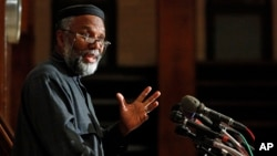 FILE - Imam Johari Abdul-Malik, director of outreach at the Dar Al Hijrah Islamic Center, speaks during a news conference in Falls Church, Va., , Nov. 9, 2009.