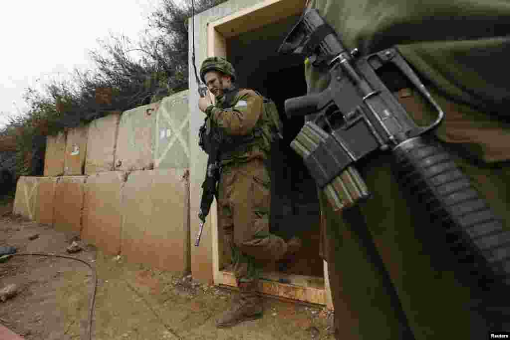 An Israeli soldier walks out of a military bunker on the Israel-Lebanon border near the northern town of Metula, Israel, Dec. 29, 2013.