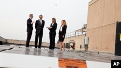 FILE - President Barack Obama tours solar panels on the roof of the Energy Department in Washington, Thursday, March 19, 2015.
