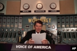 FILE - President Ronald Reagan gives his weekly radio address at the Voice of America studio in Washington, Nov. 9, 1985.