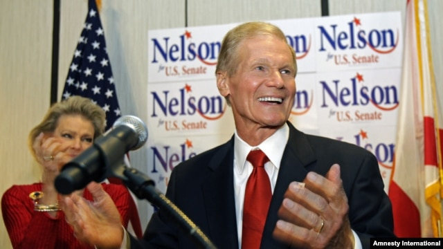 U.S. Sen. Bill Nelson, D-Fla. thanks supporters at a re-election party in Orlando, Florida, Tuesday, Nov. 6, 2012. On his left, is wife Grace Nelson.