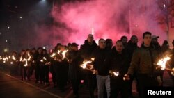Members and supporters of several nationalist organizations take part in a march in commemoration of the late Gen. Hristo Lukov, a Bulgarian army commander, in Sofia, Bulgaria, Feb. 16, 2019.