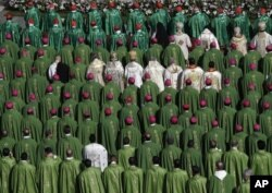 FILE - Bishops and cardinals attend a Mass officiated by Pope Francis at the opening of the Synod of Bishops, in St. Peter's Square of the Vatican, on October 3, 2018. (AP Photo / Alessandra Tarantino)