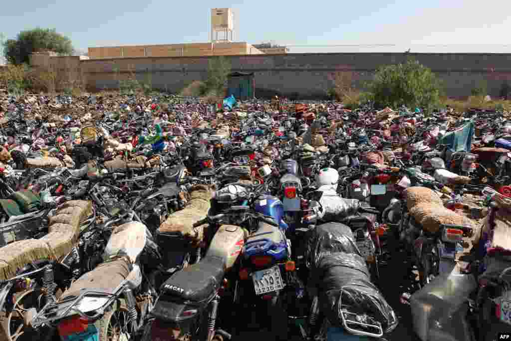"Motorcycles that were seized at the police headquaters in Sana'a, Yemen, after their owners violated a 15-day ban on motorcycles. Yemen began enforcing a temporary ban on motorbikes in the capital to prevent ""shoot and scoot"" attacks as al-Qaida suspects on a motorbike elsewhere killed an army officer."