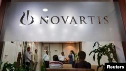 People gather at Novartis India headquarters in Mumbai April 1, 2013.