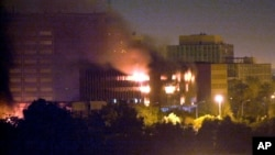 FILE - The Iraqi Ministry of Planning burns after being hit by a missile in Baghdad in March 20, 2003. U.S. forces launched their long-awaited war against Saddam Hussein, targeting him personally with a barrage of cruise missiles and bombs as a prelude to invasion.