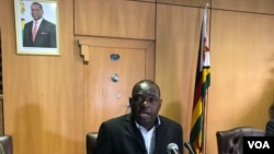 Minister Sibusiso Moyo Zimbabwe's Foreign Affairs – speaking to reporters Harare (08/12/2018) - laments the move by President Donald Trump to sign the Zimbabwe Democracy and Economic Recovery Amendment Act of 2018, last week. (C. Mavhunga/VOA)