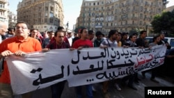 Protesters shout anti-government slogans during a rally against a new law restricting public gatherings, in downtown Cairo Nov. 26, 2013.